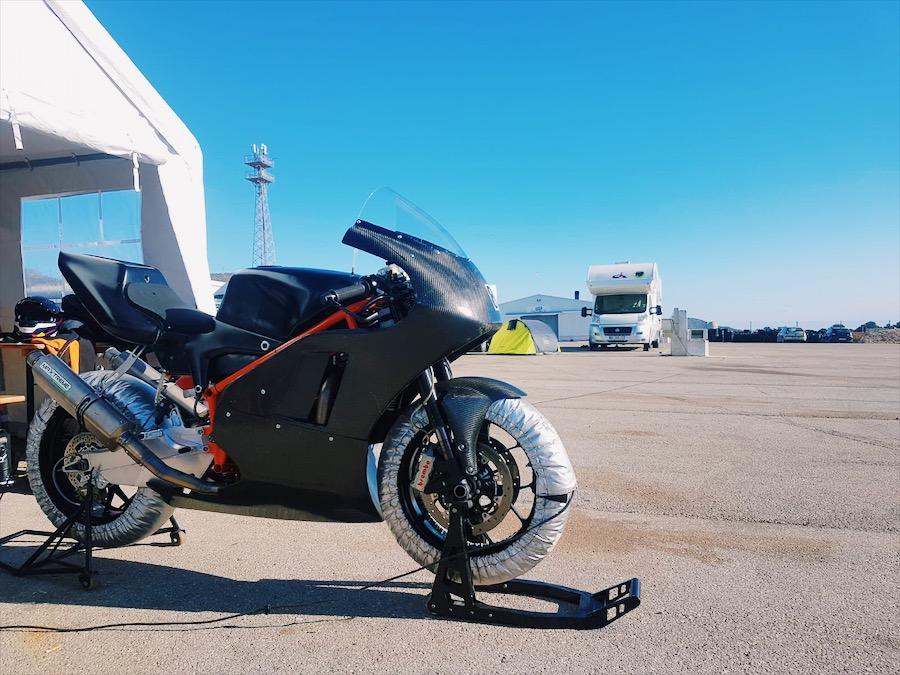 Bike parked under blue sky before racing